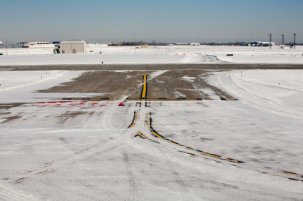 Snow and slush, when not properly plowed off runways, can increase minimum takeoff and landing distances