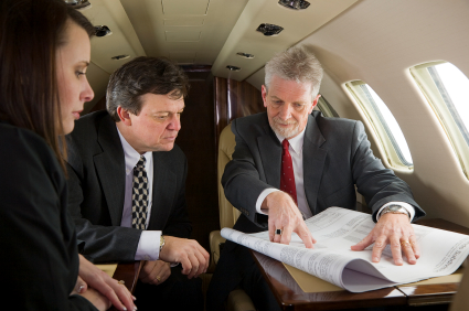 Business executives discuss project on private jet
