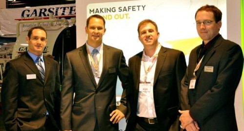 Stratos Jets air charter agents pose at the NBAA Convention in October 2011