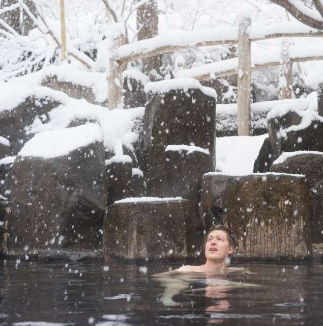 Western travelers arriving on private flights can immerse themselves, quite literally, in Japanese custom when staying at a ryokan onsen.