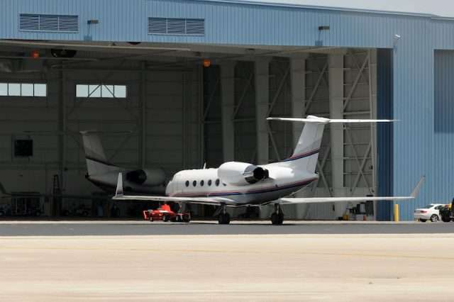 Private jet charter aircraft in a hangar