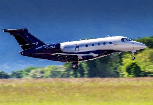 Embraer Legacy 450 jet charter taking off