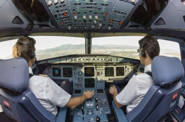 jet charter pilots in cockpit