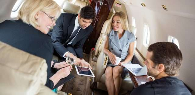 business people on a private jet charter
