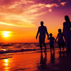 family using private jet charters for beach vacation