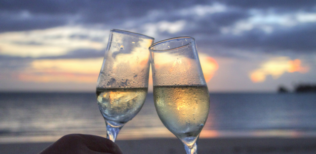 two wine glasses and sunset