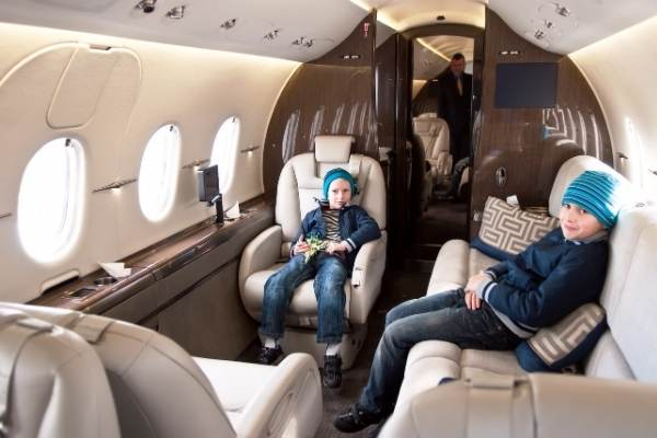 two boys on private jet charter