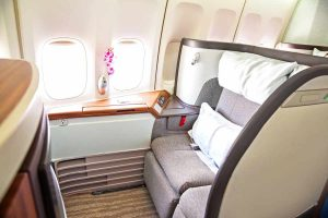 empty first-class seat on a commercial airline flight
