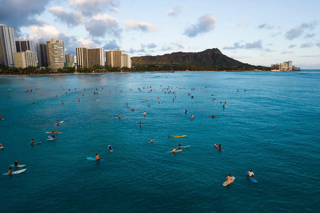 Surfers in the water near Waikiki, Hawaii.